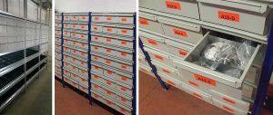 particolare scaffalature per magazzino con piani accessoriati con sponde e divisori trapezoidali e cassettiere metalliche per componenti termoidraulici modello E40 euroscaffale
